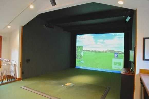 The home has a heated studio and golf simulator.