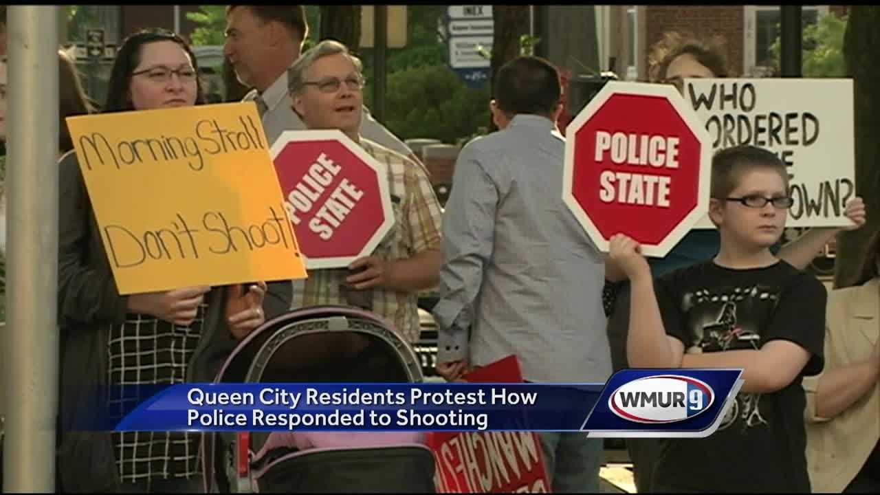 A group of West Side residents gathered outside City Hall Tuesday night to protest how the city responded to the shooting of two officers last month.