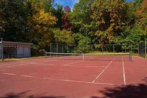 A tennis court is located on the property.