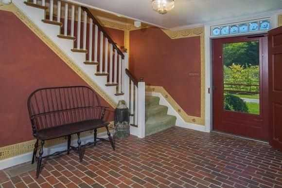 The home has brick flooring in some spots.