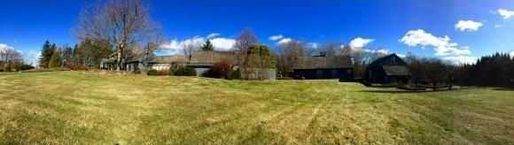 A wide shot of the home showing a large barn.
