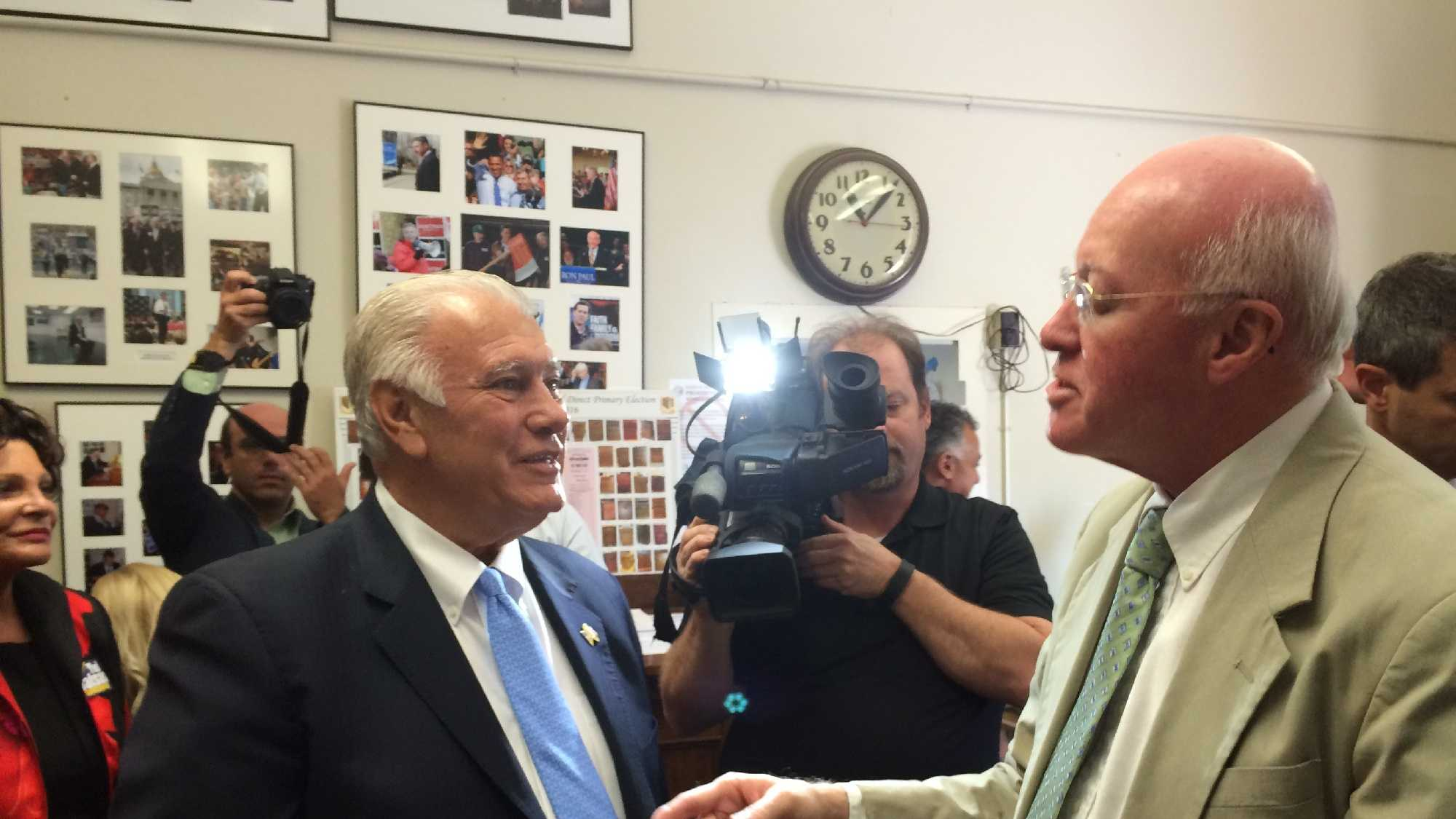Manchester Mayor Ted Gatsas (left) is greeted by Secretary of State Bill Gardner as Gatsas filed his candidacy for governor on Friday. (John DiStaso/WMUR)