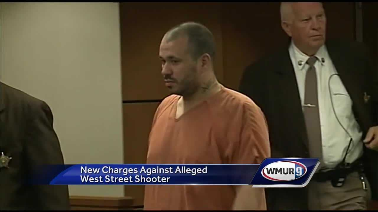 A man accused of firing shots into a Manchester apartment building was back in court Monday to face new charges.