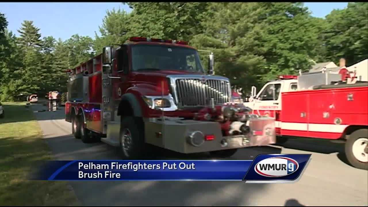 A four-alarm brush fire burned in Pelham Thursday afternoon.