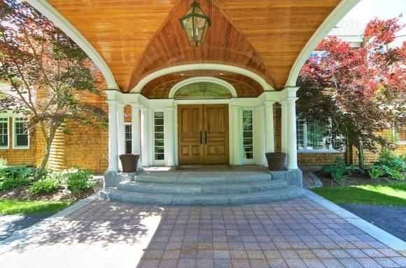 A large stone pathway leads up to the home's front entrance way.