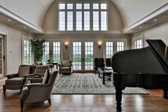 The grand room exits to a balcony that over looks the home's property.