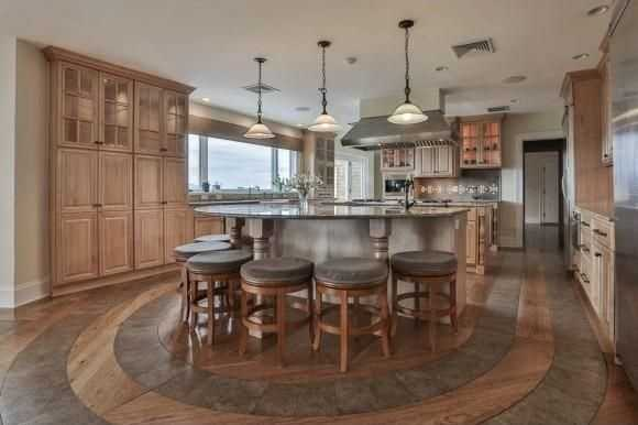 The gourmet kitchen has island-style seating and much more.