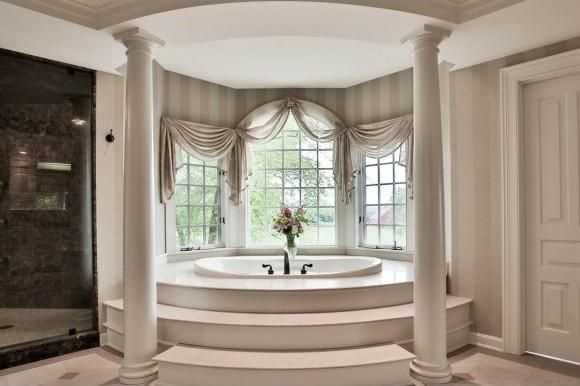 One of the 14 bathrooms comes equipped with an extravagant Jacuzzi.