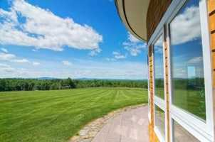 The home offers total privacy with a spectacular 180-degree view of the grounds, pastures and mountains.