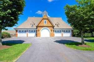 The home ha a 10-car garage and a helipad.