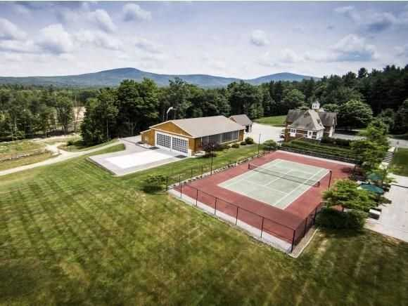 A look at the home's tennis court, FAA hangar and helipad.