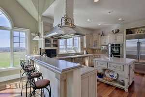 The gourmet kitchen has a 6-top burner stove, among many other amenities.