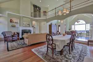 A cat walk runs above the home's dining area.