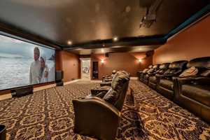 The home has its own private movie theater with a large screen for viewing pleasure.