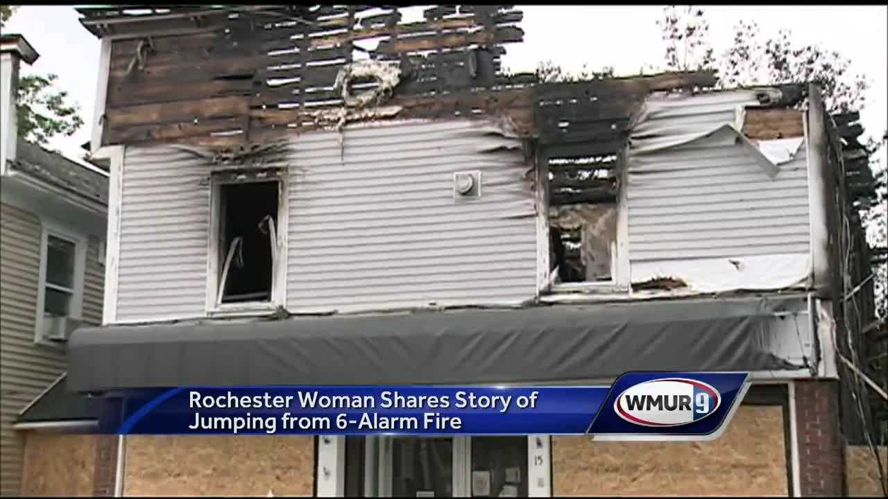 A Rochester woman survived a 6-alarm fire in Rochester by jumping out a window.