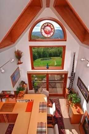 A large picture window offers natural lights and a wonderful view.