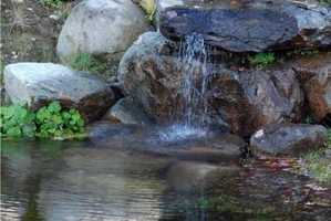 Another pond features beautiful rock formations.