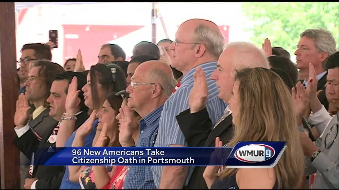 Nearly 100 new Americans take their oaths of citizenship