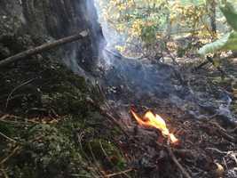 Crews battled a three-alarm brush fire Thursday in Hooksett.