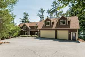 The large garage boasts plenty of room and has a recreation room that sits above.