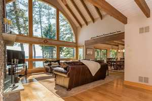 Oversized windows offer stunning views of the lake from the home's living area.