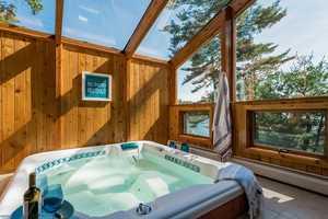 A large spa area his a hot tub.