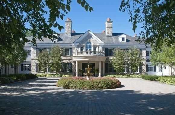 The two homes were built between 2000 and 2004 and total over 63,000 square feet of elegant living space.
