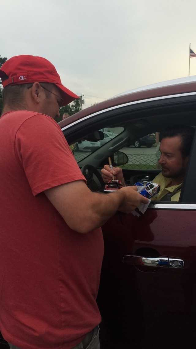 Kurt Busch signs autographs for fans at Concord Municipal Airport.