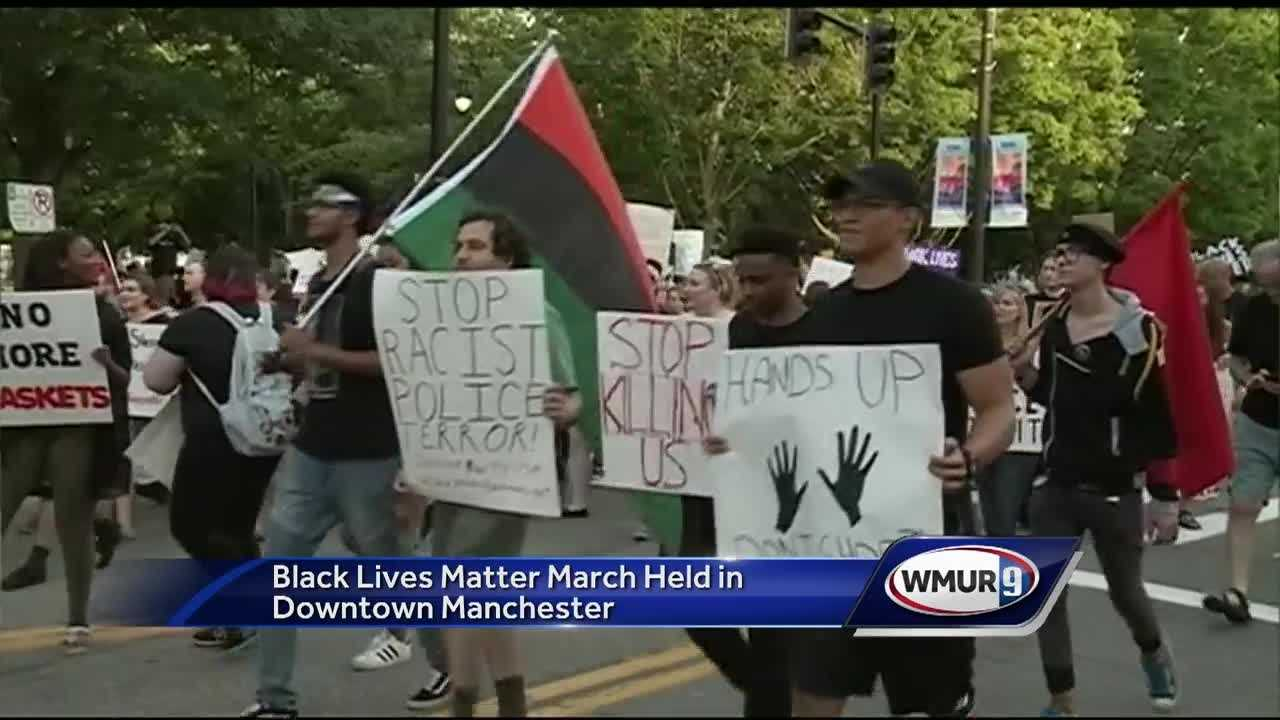 Hundreds of people march in peaceful black lives matter protest in downtown Manchester.