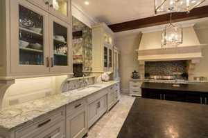 The kitchen has marble counter tops.