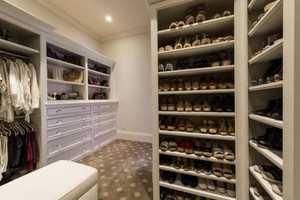 A look inside a spacious walk-in closet.