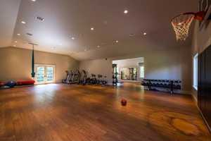 Here's a look inside the home's gym that has basketball court.