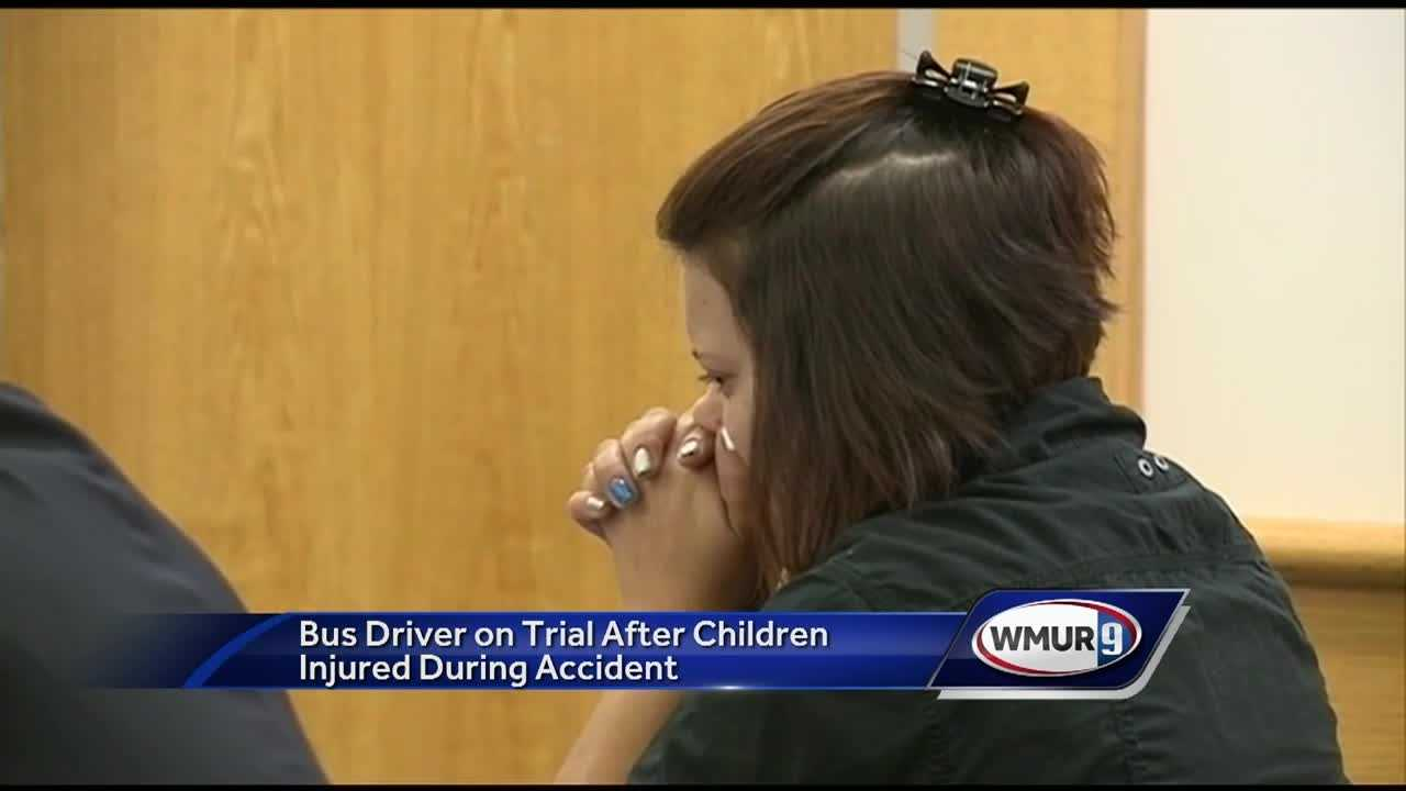 A trial began Tuesday for a bus driver accused of crashing her bus with students on board while she was downloading an app for her phone.