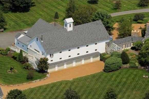 The home has an Olympic-sized indoor riding ring and an 8-stall barn.