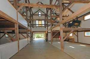 The home has an impressive 40 X 90, five-story post and beam barn.