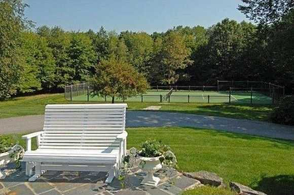 The home also has an outdoor tennis court.