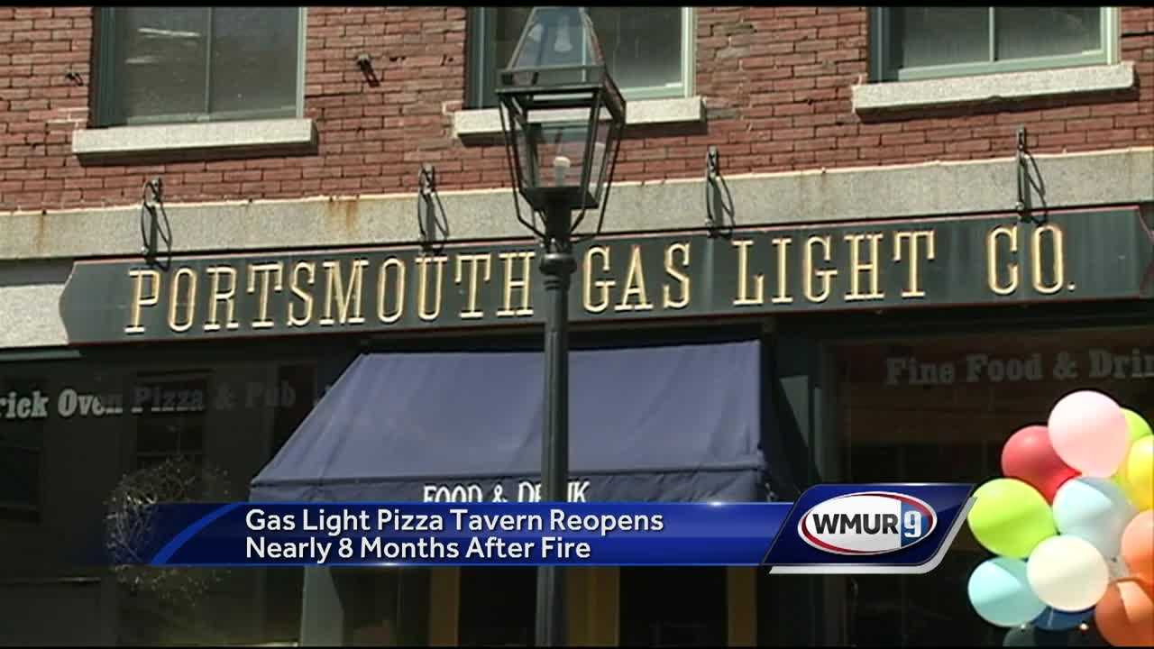 Nearly eight months after flames tore through a popular Portsmouth restaurant, it was back open for business Wednesday.
