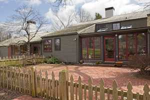 The property includes storage shed, chicken coop and fenced garden withraised beds.