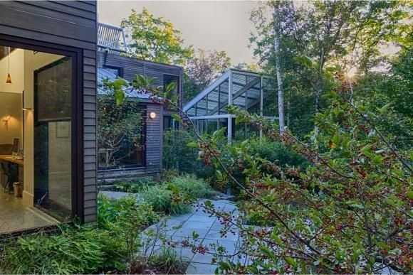 """A home is described as a """"sustainable modern masterpiece of proportional drama."""""""