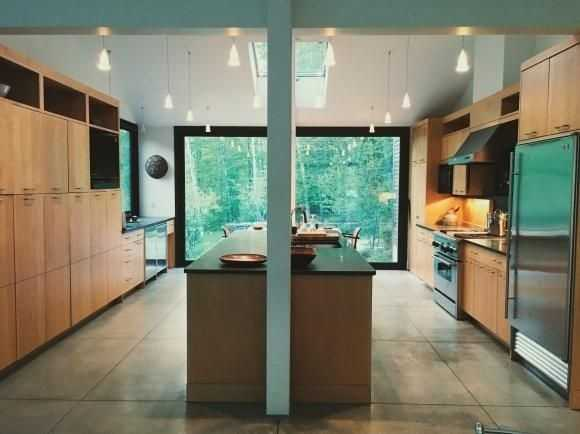 The kitchen has a massive island with natural light.