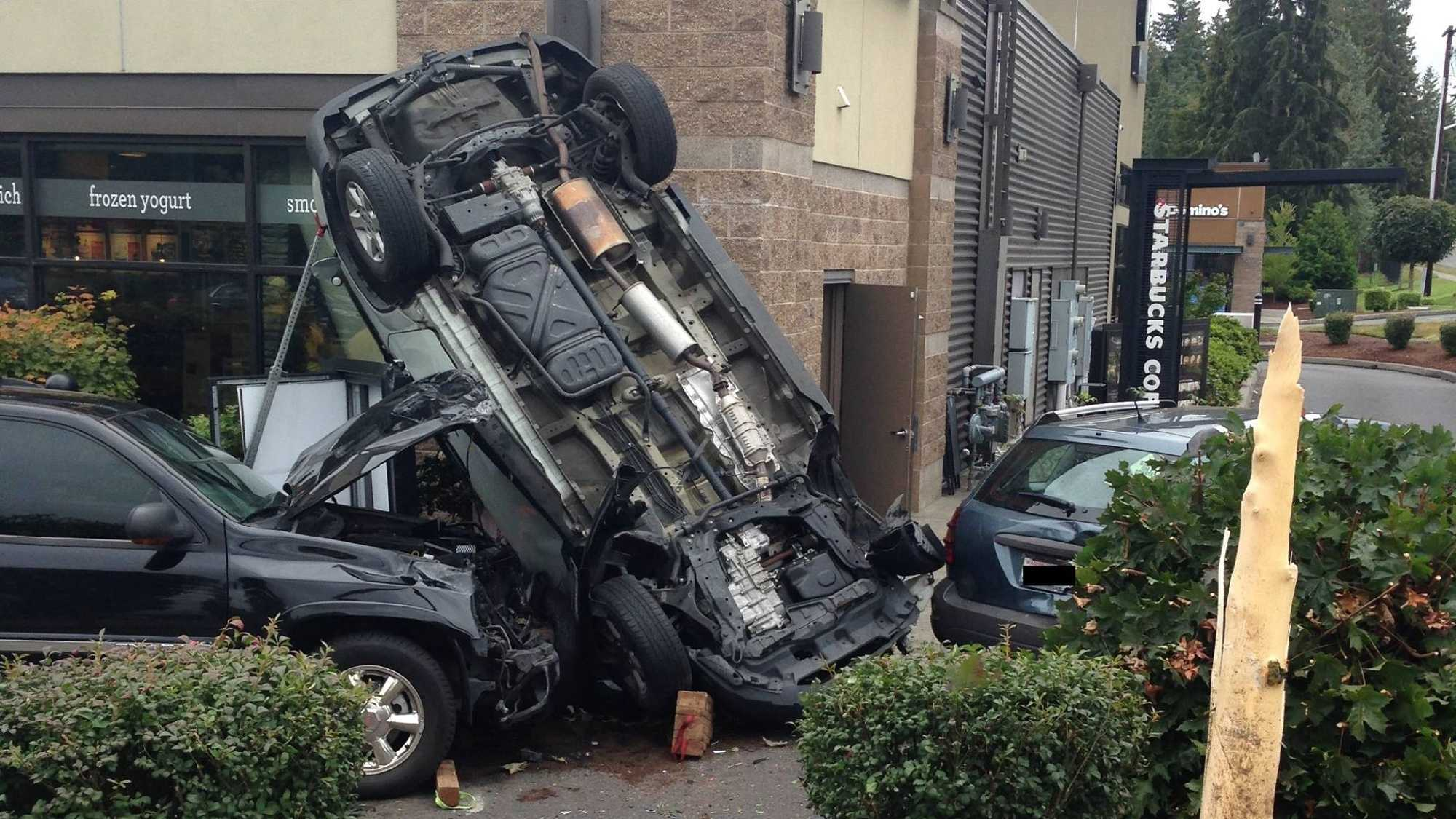 woman flips vehicle crashes into cars in starbucks drive thru