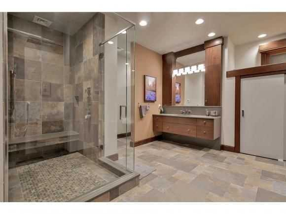 This bathroom features hand-built granite walls.