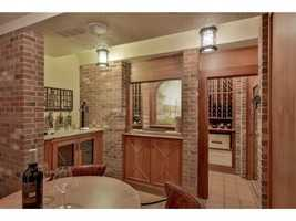 A look at the home's wet bar and wine cellar.
