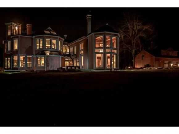 The home illuminated at night.
