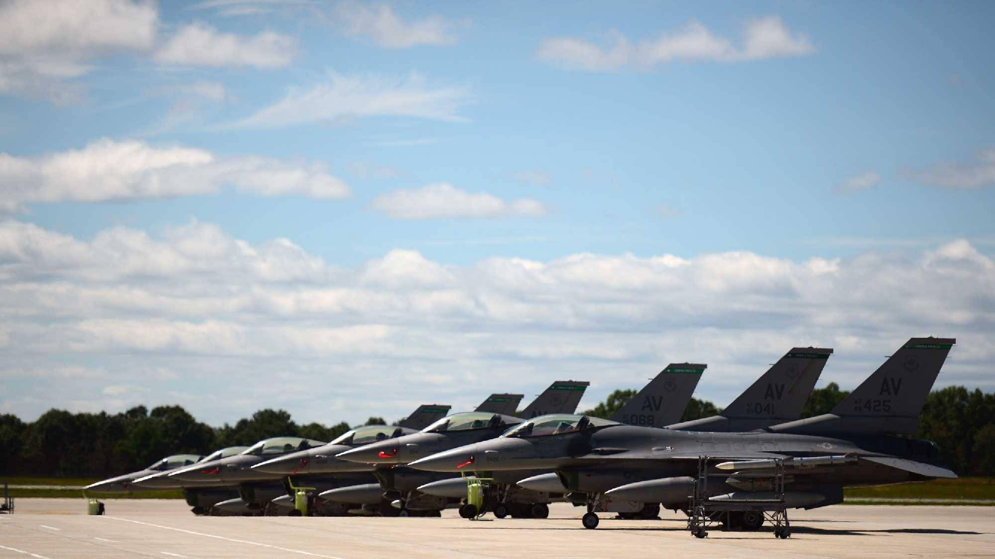 U.S. Air Force F-16 Fighting Falcons, 555th Fighting Squadron, Aviano Air Base, Italy, on the parking ramp of Pease Air National Guard Base, N.H., Aug. 17, 2016. The aircrew landed in the early morning hours for fuel and crew rest.