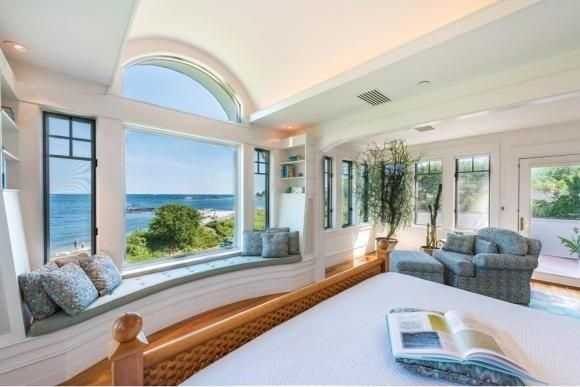 The home has many walls of windows that offer brilliant views of the ocean.