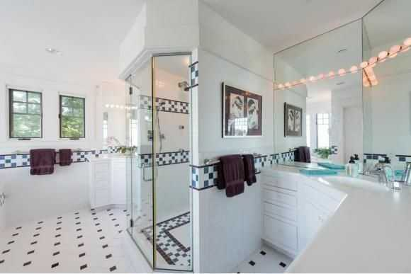 A look inside the home's tiled, spa-like bathroom that features a whirlpool and walk-in shower.