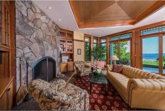 Here's a look at a sitting area in the home with a fireplace.
