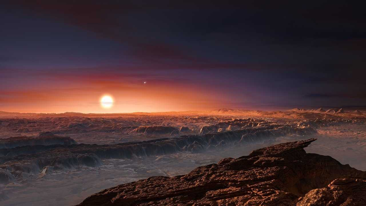 This artist's impression shows a view of the surface of the planet Proxima b orbiting the red dwarf star Proxima Centauri, the closest star to the Solar System.