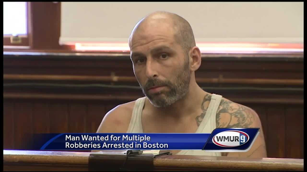 A man suspected in bank robberies in New Hampshire and Massachusetts was arrested Wednesday after a standoff in Boston.